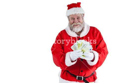 Santa claus showing currency notes