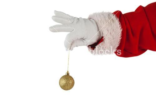Santa claus holding christmas bauble