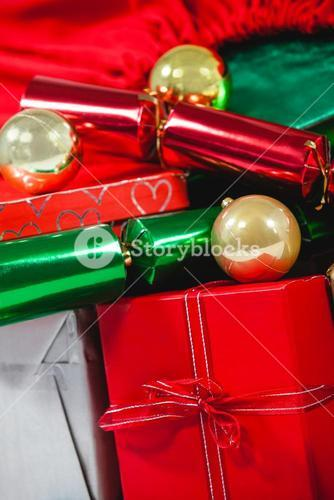 Close-up of christmas presents and bauble