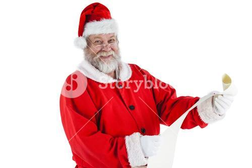 Portrait of santa claus smiling and holding scroll