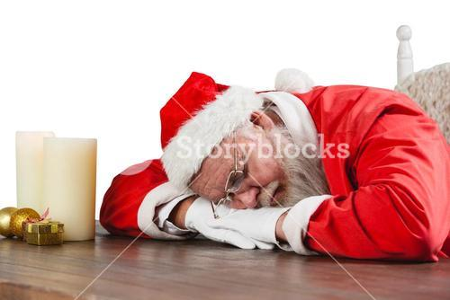 Santa claus sleeping at desk