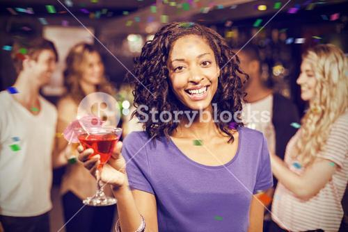 Composite image of portrait of smiling girl having cocktail with her friends