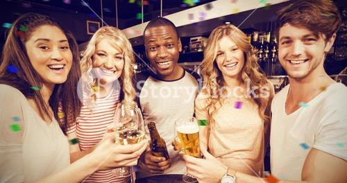Composite image of portrait of friends toasting with beer and wine