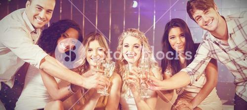 Composite image of friends toasting with champagne
