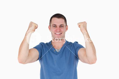 Smiling man with the fists up