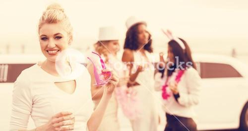 Portrait of women holding champagne and sunglasses