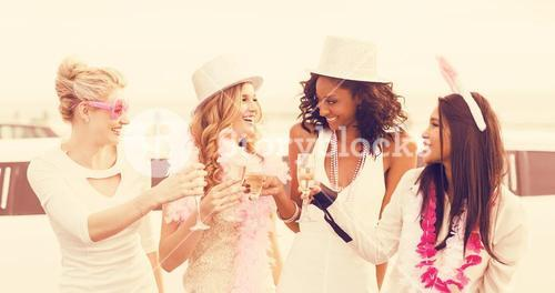 Women toasting champagne while standing