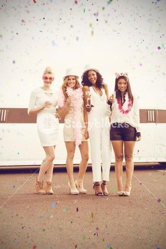 Composite image of portrait of women holding champagne together while standing