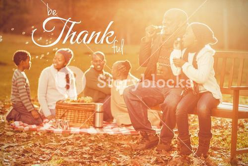 Composite image of digital image of happy thanksgiving day text greeting