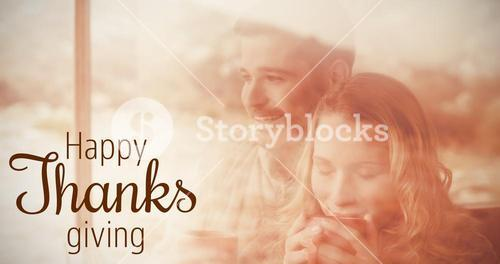 Composite image of thoughtful couple with coffee cups seen through cabin window