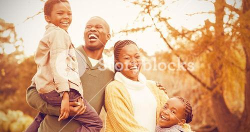 Portrait of a smiling young family laughing