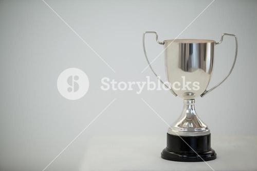 Silver trophy on grey background