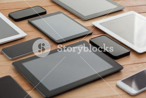Mobile phones and digital tablets on table