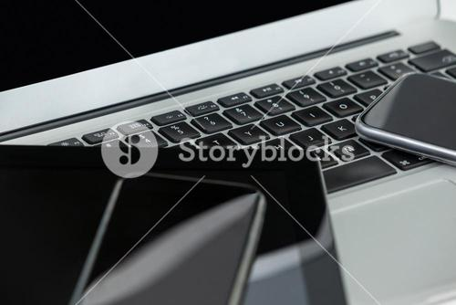 Laptop, digital tablet and mobile phones on white background