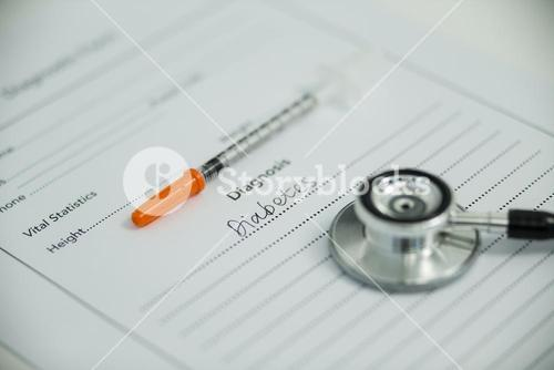 Injection with diabetes diagnosis and stethoscope
