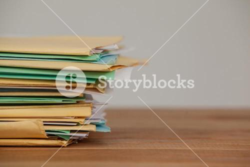 Files on wooden desk