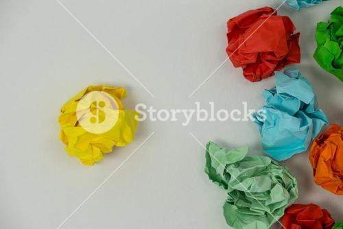 Colorful crumpled paper on a white background