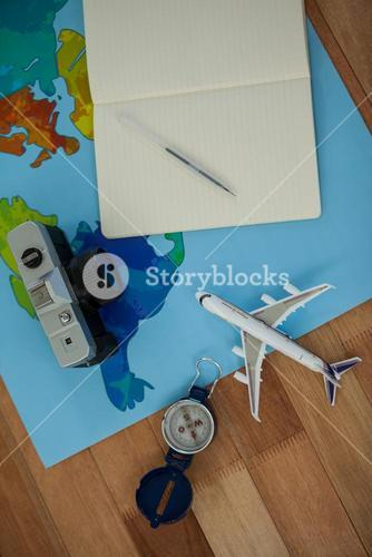 Digital camera, dairy, pen, map, compass and airplane model