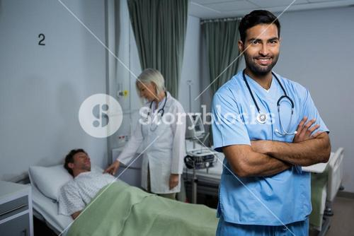 Portrait of surgeon standing in ward