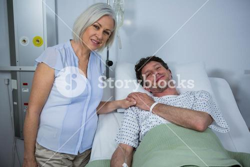 Doctor consoling a patient in hospital