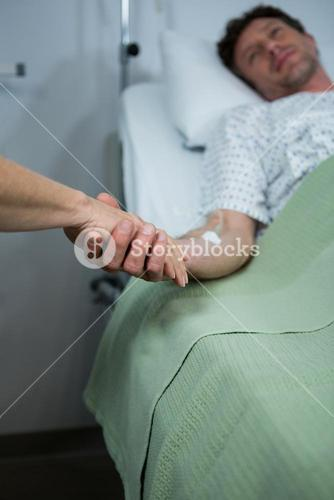 Doctor consoling a patient