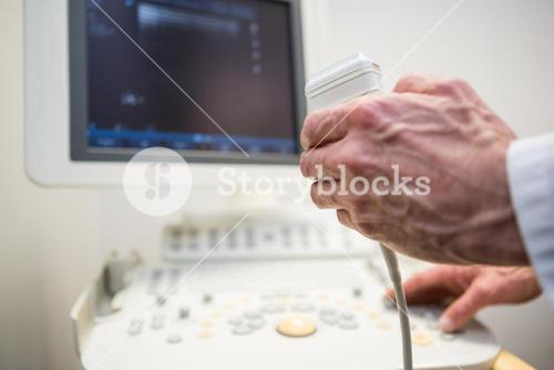 Doctors using sonography machine