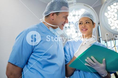 Surgeons discussing over file
