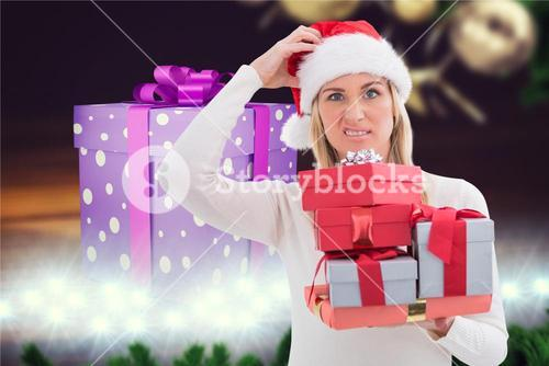 Confused woman holding stack of christmas gifts