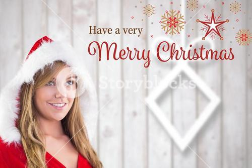 Woman in santa costume with christmas greeting