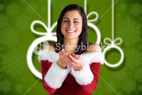 Beautiful woman in santa costume with hands cupped