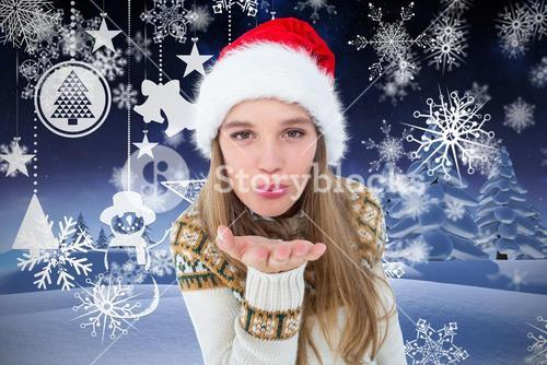 Beautiful woman in santa claus costume blowing a kiss