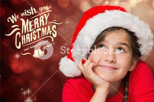 Thoughtful cute girl in santa hat with hand on chin