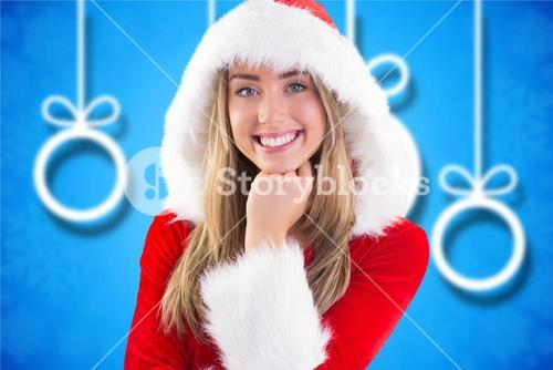 Beautiful woman in santa costume with hand on chin