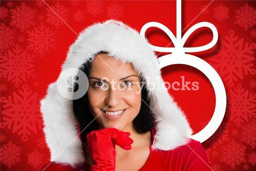 Beautiful woman in santa hat with hand on chin