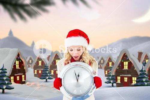 Shocked woman in santa hat holding a wall clock