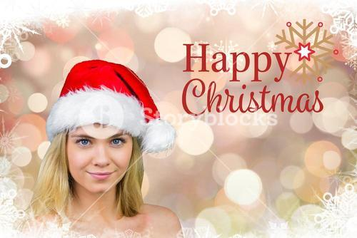 Woman in santa hat with christmas greetings