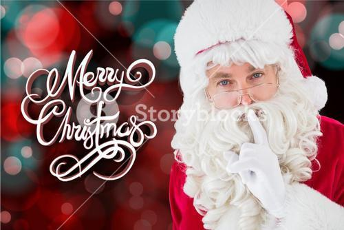 Santa claus with on finger on lips