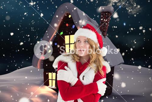 Woman in santa costume shivering with cold