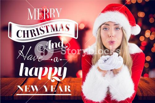 Portrait of woman in santa costume blowing a kiss