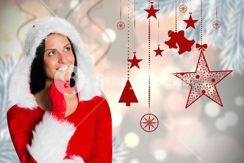 Thoughtful woman in santa costume against digitally generated background