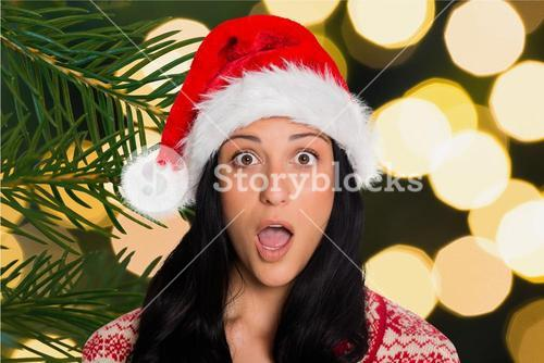 Portrait of shocked woman in santa hat