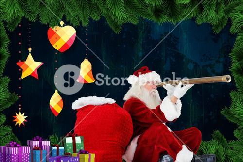 Santa claus looking through binoculars