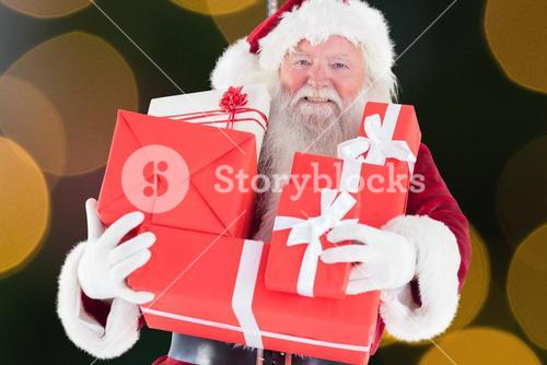 Santa claus holding stack of gift boxes