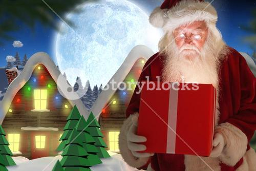 Santa claus looking at christmas gift