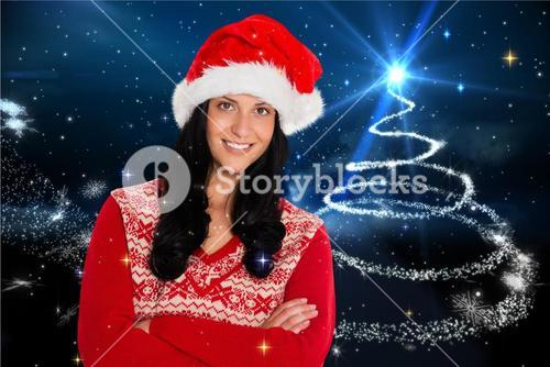 Beautiful woman in santa costume with arms crossed
