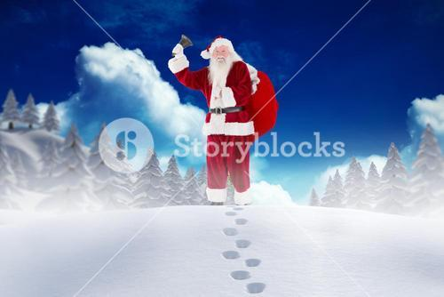 Santa claus standing in snow during christmas time