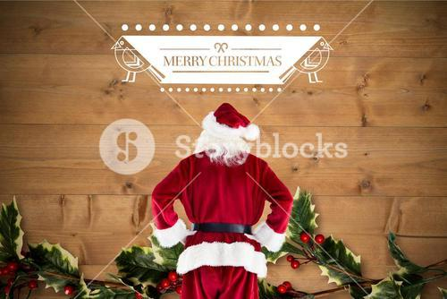 Santa claus standing with hands on hips against digitally generated background