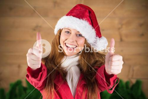 Portrait of beautiful woman in santa hat giving thumbs up
