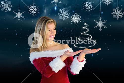 Smiling woman in santa costume pretending to hold a imaginary christmas tree