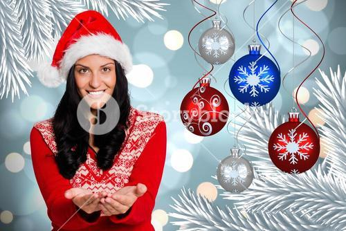 Happy woman with hands cupped standing against digitally generated christmas background